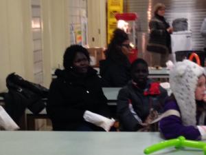 Third grader Jok Mayom and his mother enjoy poetry night.